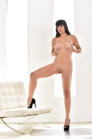 Dark-haired girl Mercedes Carrera revealing her forms