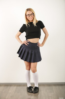 Sweet schoolgirl Alina West undressing her sexy uniform