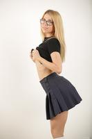 Sweet schoolgirl Alina West undressing her sexy uniform