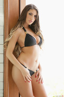 Undressing and posing session from sexy August Ames