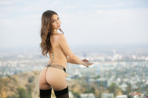 Fascinating brunette Jenna Sativa takes off stockings