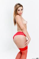 Carmen Caliente revealing her sexy body in a Santa hat