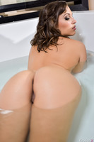 Astounding Lily Love has her juicy pussy shown in a bath