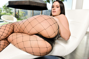 Fishnet stockings of excellent brunette Roxy Raye