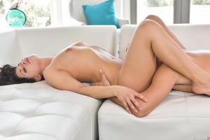 Mick Blue pleases tanned pornstar Gracie Glam on a couch