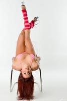 Stunning redhead Heidi Van Horny posing in high heels
