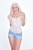 Naomi Woods undresses her tight shirt and shorts