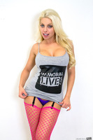 Britney Amber posing in her wonderful pink stockings