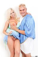 Blonde pornstar Britney Amber shows her ass in a dress