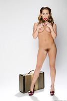 Fascinating Carter Cruise undressing her hot skirt