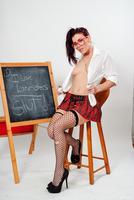 Roxy Lane undresses her sweet school uniform in high heels