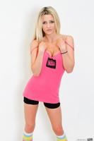 Blonde pornstar Sienna Day showing off her stunning body
