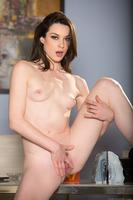 Astounding pornstar Stoya undressing her black pants