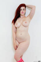 Redhead pornstar Jaye Rose revealing her marvelous tits