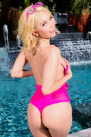 Blonde teen Aaliyah Love undresses her shorts at the poolside