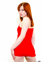 Naughty redhead Kira Lake showing her tight forms