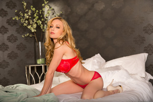 Kayden Kross posing in her seductive red underwear
