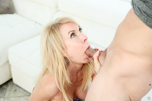 Erica Lauren does a sexy pole dance before sucking cock