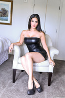 Dark-haired pornstar Sunny Leone in a tight outfit