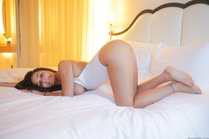 Smoking hot brunette with big tits Karlee Grey posing