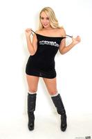 Blonde pornstar AJ Applegate posing in her tight skirt
