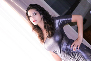 Excellent pornstar Sunny Leone in a tight black skirt