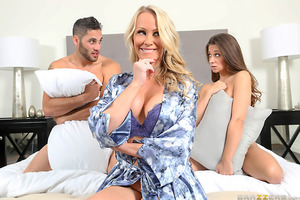Returning home from a night out,  Damon Dice brings home his girlfriend, Cassidy Klein, to have sex for the first time. Both of them can't wait to get each other naked. Only problem is that they have woken up his stepmom, Simone Sonay, in the process. To