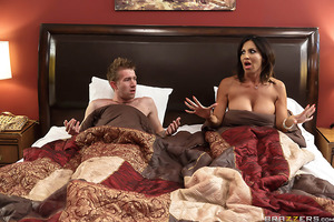 Tara and her stepson Danny didn't realize they'd have to share a motel room on their road trip. With only one bed and a whole lot of sexual tension, it's hard to resist temptation.  Danny gets a massive erection and Tara does her best to help him out by j