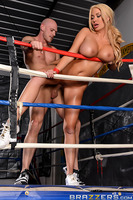 Get ready for a ringside view of Summer Brielle's knockout knockers! This sporty slut may have sweat through her tiny tank top, but the action has only just begun, as Johnny enters the ring and fucks her up against the ropes. Her big fake tits bounce with