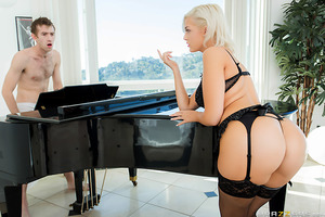 Jenna Ivory showed up ready to roll with her ripe ass barely covered, flashing peeks at her beautiful dark asshole hiding behind her G-string. With oil hosing down the sumptuous, thick cheeks of her plump butt, Jenna joined Danny D by the piano to tease y